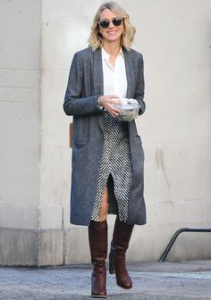 Naomi Watts Is the Epitome of Chic Fall Fashion in N.Y.C. She was spotted on set of her latest T.V. project, Gypsy, in an Isabel Marant tweed midi skirt white blouse, oversized gray blazer, and a pair of slouchy brown leather boots.
