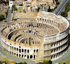 We're all Roman at heart. Really. And this.. the Colleseum.. is awesome. If I ever win the lottery I am going to build a bathhouse fed by an aquaduct and have a mini colleseum just to play frisbee in.