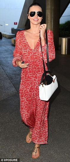 Stylish:Given her tiring flight Miranda looked surprisingly fresh in a plunging bohemian ...