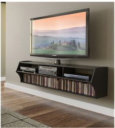 The minimalist, off-the floor design of the Altus Plus eliminates the need for a separate wall mount TV bracket and is the perfect pairing for any flat screen TV up to 60 inches. This boasts three compartments for A/V components and a bottom shelf that has room for your media such as 137 Blu-Ray Discs or 93 DVDs.