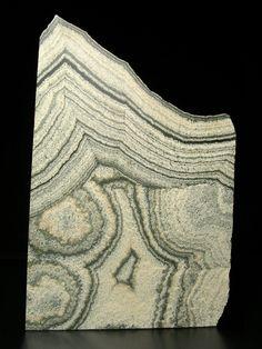 Skarn-- it's kind of like a carrier rock. It's very under-appreciated, but often has valuable mineral deposits in it.