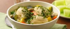 Load up at the farmers' market for this chicken stew, with more frozen vegetables added for flavor and served with dumplings made from refrigerated flaky biscuits.