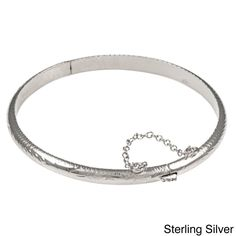 <li>Bracelet features hand-engraved scrolled floral and leaf designs</li> <li>Jewelry is available in sterling silver, yellow gold over silver or rose gold over silver</li> <li>Accent your casual or dressy wardrobe with a lovely bangle</li>