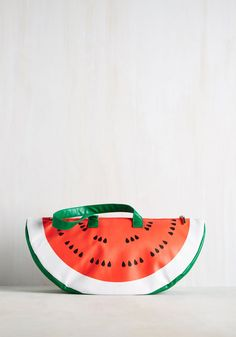 "Give a whole new meaning to ""keepin' it fresh"" with this insulated cooler bag. Fashioned into the bright wedge of a watermelon, this super chill tote is too exceptional to pass up."