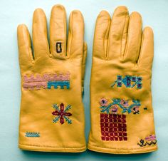 embroidered work gloves, Sampler inspired, but casually placed stitches seem right for work gloves - don't you love her 'sapphire ring'?