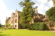 Huntsham Court, Devon. 27 bedrooms, 24 ensuite. £7500 - £9000 for a weekend. no corkage or preferred suppliers. complimentary use of banqueting crockery, cutlery, glassware, tables, chairs. sleeps 72, events up to 120. licensed for weddings or church on driveway