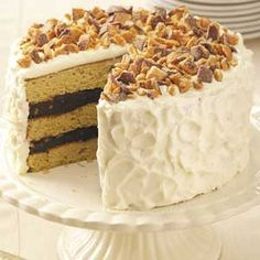 Blue-Ribbon Peanut Butter Torte-  Had this cake at a luncheon today.  WOW!!!  It is absolutely amazing.  The chocolate filling is so smooth and the icing is like silk.
