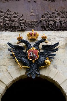 Double-Headed - The Russian Coat of Arms above the Peter's Gate (Petrovskye Vorota). Entrance to the Peter and Paul fortress (Saint Petersburg, Russia). The double-headed eagle is made from a lead and weighs more than 2 tons. Photo: Constantine Zuev