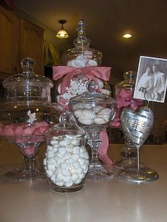 Glass candlesticks + lidded containers = homemade apothecary jars