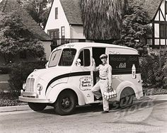 The milkman appeared every morning, Monday to Friday, carrying fresh bottles of milk to the little 'milk box'...these tiny cubicles were built into the exterior walls of mid century homes.