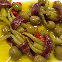 "This pintxo is called ""Gilda"", after the 40´s movie, because it´s hot and spicy. Anchovie, Basque guindillas (a kind of mild local chile, it´s not hot) and an olive, all on olive oil. Grab them by the toothpick and see how you start salivating..."