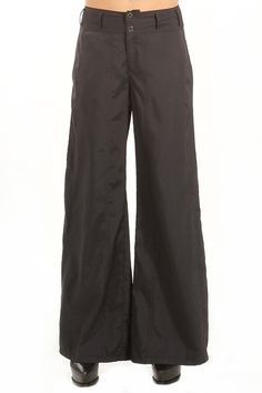The Sugarlips 70's Flare Pants are an awesome pair of pleated wide leg pants. Features front and back pockets. Button/zip closure. Take it back to the 70's and pair it with a flowy bell sleeve top and a fur vest. #MyLuluCloset #Sugarlips #Storenvy #Sales #Pants