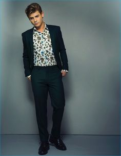 Apuje Kalu outfits Garrett Clayton in a Calvin Klein Collection suit, Kenzo shirt, and Bar III shoes for Ferrvor magazine.