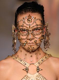 Givenchy's spring/summer 2016 show was every bit the spectacle, and the makeup was no exception — most notably on the faces of four models, who wore elaborate bejeweled masks that were applied directly onto their skin. A painstaking process comprising gold, pearl and white beading, pieces of fabric, and professional adhesive, the entire undertaking required nearly seven hours to complete makeup artist Pat McGrath's vision. (Photo: Edward James/WireImage)