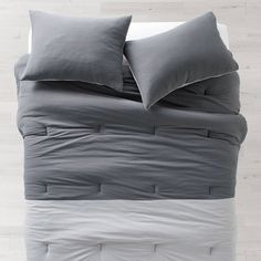 Shades of grey. This light grey and dark grey bedding provides a neutral palette for any minimalist's room. A clean look with a full and cozy feel, the Two-Tone Jersey Duvet Cover and Sham Set lets you wrap up in warmth and decorate however you choose. Queen Bedding Sets, Duvet Sets, Dark Grey Bedding, College Bedding Sets, Utility Bed, Linen Bedding, Bed Linen, Dorm Essentials, Bedding Basics