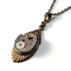 c3345c067e2 Classic vintage watch movement necklace featuring exposed gears and real  jeweled bearings on a brass Art