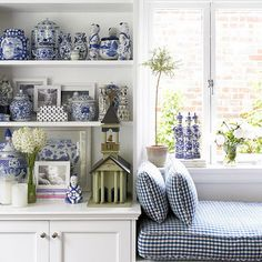I love this vignette of cool blue & white cosy reading nook!