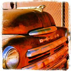 Front grill of an old 50's dodge truck outside Price, UT. They s dvr hould use this old ram emblem on the new trucks.