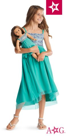 Made to match the doll-sized version, this beachy dress features iridescent glitter at the bodice, an empire waist, and a floaty layer of mesh over a jersey lining. Cotton/spandex. Imported. Aqua. Sizes 6-16
