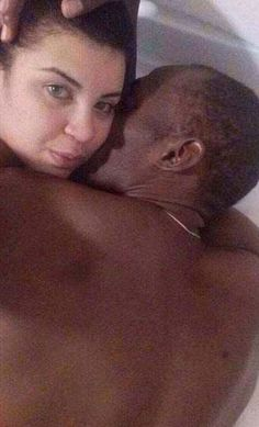 """She told Globo the pair met while partying, and later posted images of their night in a Whatsapp group.  """"I never wanted to be famous, I'm dying of shame,"""" Duarte is quoted as saying.  One of the photos shows Bolt with his arm around Duarte, while in another he appears to be planting a kiss on her cheek."""