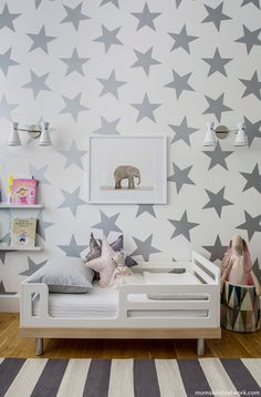 silver star wallpaper, elephant photo, gray striped rug // toddler room