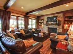 Livingroom with plenty of natural light and a great fireplace, neutral colors, cushy leather furniture