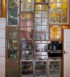 Piet Hein Eek custom made kitchen wall -very interesting cupboards!