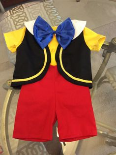 Pinocchio costume (sizes 6 months to 5T) 5 pieces shirt, short, vest, bow and hat  The size 6 months. Shirt length - 10  Waist - 20  Shoulders - 6  Short length - 10   The size 1T. Shirt length - 12  Waist - 22  Shoulders - 8  Short length - 12   The size 2T and 3T. Shirt length - 14