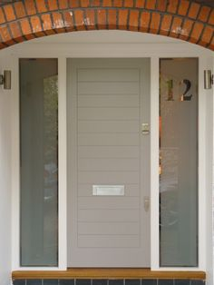 This subtle grey-sky coloured door is the epitome of contemporary chic.