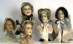 Four wax mannequin ladies heads made by Charles.