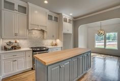 Transitional Kitchen with Complex Marble Tile, Raised panel, Limestone counters, One-wall, Kitchen island, Stone Tile, Flush