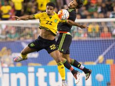 Jamaica midfielder Garath McCleary, left, and Mexico defender Oswaldo Alanis compete for a header during the second half of the CONCACAF Gold Cup final match in Philadelphia. Mexico won 3-1.  Bill Streicher, USA TODAY Sports
