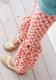 Sunset Benny Leggings  Everyone's favorite benny leggings take center stage in an eye-catching red and cream windmill pattern accented with the cutest buttons. The Sunset Benny Leggings will help you transition from fall to winter with ease. Item #: B1664 $36.00