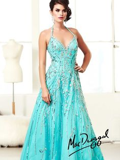 Stunning sequins, crystals, and rhinestones are hand beaded onto this gorgeous gown by Mac Duggal