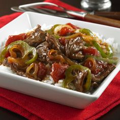 Juicy strips of beef sirloin steak tossed with bell peppers, onions and tomatoes in a stir fry sauce