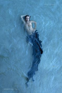 """Three Rivers Deep (book series) """"A two-souled girl begins a journey of self discovery."""" --- #fire #element #elemental #magic #devvi #nature -- The black mermaid, by Roberto Manetta"""