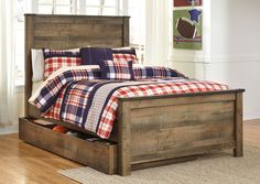 Trinell Brown Full Panel Storage Bed