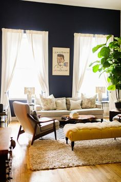 Should i paint our lounge room dining room dark purple too? Style at Home: Lisa Salzer of Lulu Frost / Photography by Trent. Love the dark walls, neutral furnishings and white curtains Home Design, Design Salon, Deco Design, Design Room, Design Ideas, Home Living Room, Living Room Decor, Living Spaces, Interior Desing
