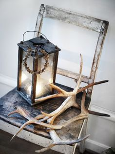 Rustic lantern and antlers.