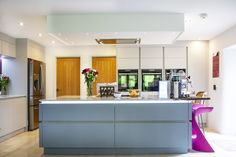 Specifications are: Masterclass units - Sutton Silk H Line Light Grey, with island in Coastal Mist Aluminium effect handle rail  Other: Worktop Tutti Frutti Quartzstone Bespoke elm breakfast bar (with a lovely butterfly feature) Splashback Merlot Decoglaze glass NEFF appliances: Slide & Hide ovens, Compact Oven with Microwave, Flexinduction Hob & Ceiling hood Dimable colour changing feature lighting suite Quooker tap Blanco sink