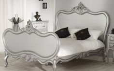 Amazing silver sleigh bed with dramatic black accents