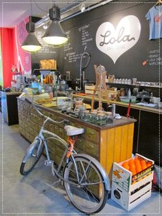Quirky smoothie bar?  I like the idea of having a different looking space for the smoothies/to-go sandwiches, even if it's all pretty much in the same space...