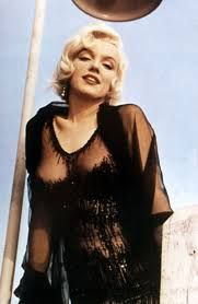 "Marilyn Monroe in ""Some like it hot"". Wardrobe by Orry-Kelly (Oscar winner). 1959. This is the black version of the ""naked dress"" also worn by her in the movie."