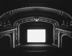 Hiroshi Sugimoto, Theatres Series. Made by holding the aperture open for the length of the movie being screened.  If I had the money to buy one work of art, this would be it.