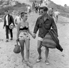 1950s couple out for a beach day. Great picture!