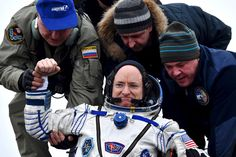 Ground personnel help U.S. astronaut Scott Kelly to get out of a Soyuz capsule shortly after landing near the town of Dzhezkazgan, Kazakhstan.  -  22 Of The Most Powerful Photos Of This Week