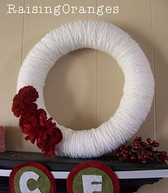 White and red seem to be a favorite color combination for yarn wreaths