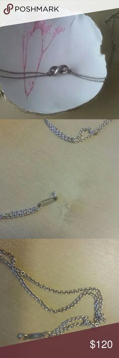 Tiffany Infinity Necklace 100 %  Authentic  Will come with little pouch and box and 3 inch necklace extender I've worn it occasionally and it might need a polish soon  Approximately 15 inches long Great everyday casual necklace Tiffany & Co. Jewelry Necklaces