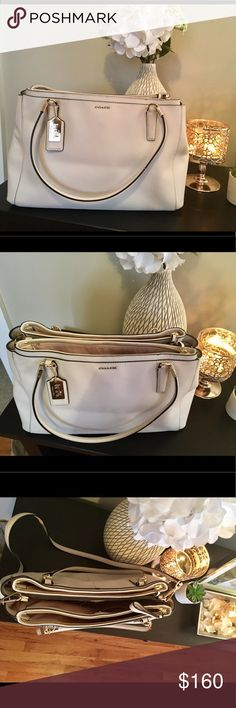 🌟PRICE LOWERED! 🌟Coach handbag 👜 Cream/off-white colored, 💯% authentic Coach handbag. This is the perfect purse for all seasons. It has been VERY gently used and in perfect condition- no marks or stains. 2 straps for multiple ways to wear. Comes with Coach dust bag. Coach Bags Shoulder Bags