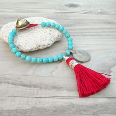 Gypsy Mala Bracelet in Turquoise Howlite with Red Tassel by GypsyIntent